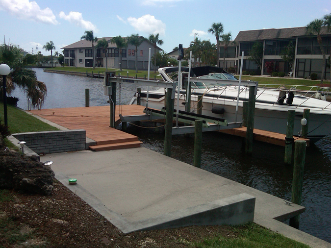 The dock, boat lift, and waterfront view.